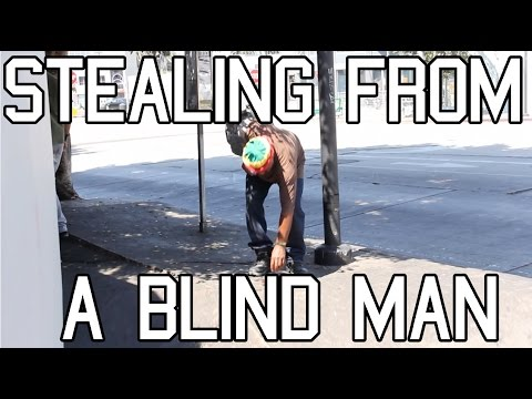 Nigger bucks steal blind man's wallet